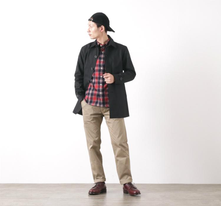 ロココのベンタイルショートコートの黒を着る足立